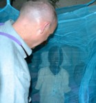 Chris Grandpre, CEO, installs mosquito nets in Africa.